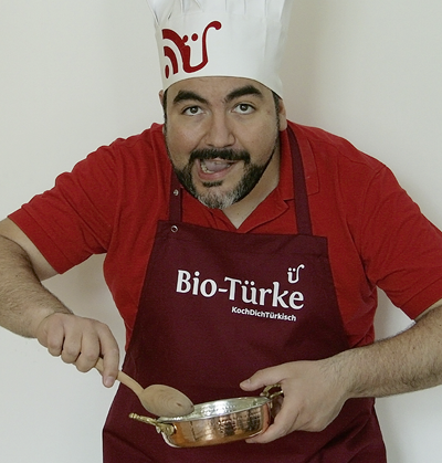 Kochschürze mit Migrationshintergrund